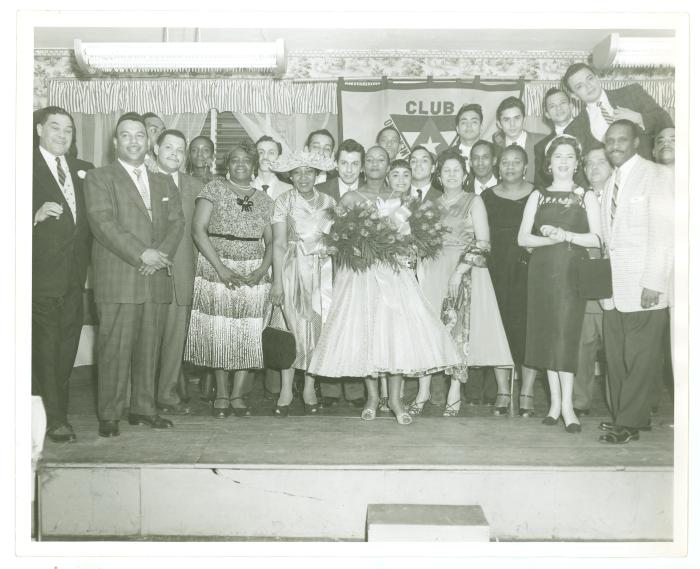 Salsa singer Celia Cruz (center) and party gathered onstage