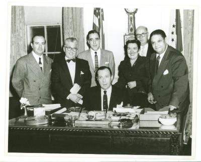 Robert F. Wagner, Jr. (seated) with Joseph Monserrat (dark glasses) and others during mayoral activities
