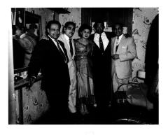 Carlos de Jesus with a group of performers in a dressing room of Teatro Puerto Rico
