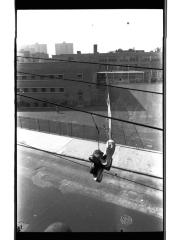 Shoes hanging from telephone wires in the South Bronx