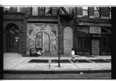 Child walking past graffiti in the South Bronx
