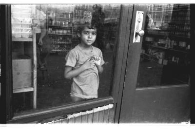 Young boy in a store on Longwood Avenue