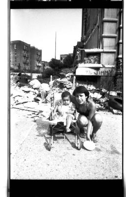 Mother and child amidst ruins in the South Bronx