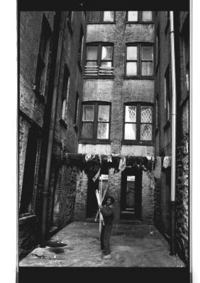 Child Between Apartment Buildings at Brook Avenue
