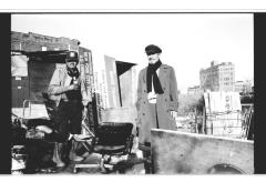 Men standing amongst ruins in the South Bronx