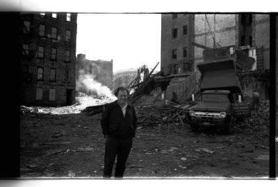 Man in front of building ruins at Longwood Avenue