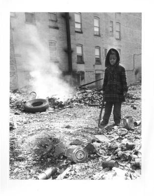 Boy among building rubble in the Bronx