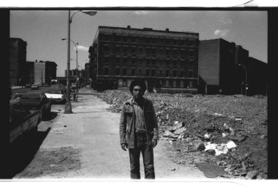 Man walking along building ruins in the South Bronx