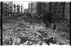 Men walking in building ruins in the South Bronx