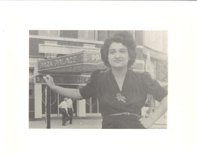 Woman posing in front of the Park Palace theater