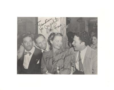 Machito (far left) at party