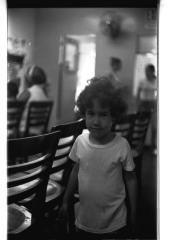 Little boy in his family home on Longwood Avenue