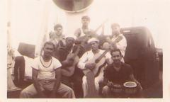 The crew of the SS Borinquen playing guitars