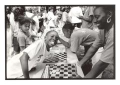 Kids Playing Checkers at the Police Athletic League