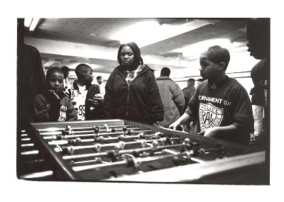 Kids Playing Foosball at the Police Athletic League