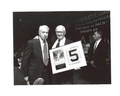 Joe DiMaggio (left) being honored with an award by the Police Athletic League