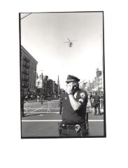 Police officer with helicopter overhead