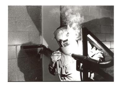 Welder at work at the Police Athletic League