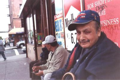 South Bronx residents sitting outside a bodega