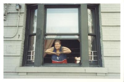 Woman at her apartment window