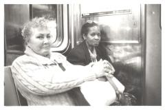 Women riding on the subway together