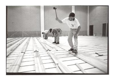 Construction workers at the Police Athletic League