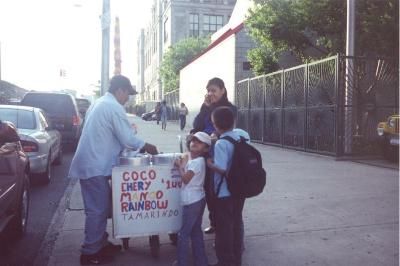 South Bronx kids getting shaved ice from a street vendor