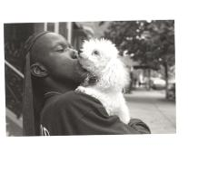 Young man being affectionate with his dog