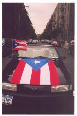 Car with Puerto Rican flag draped over the hood