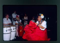 Dancer with conga drummers