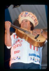 Musician wearing Puerto Rican flag imagery