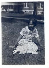 Pura Belpré seating on the lawn