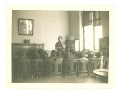 Belpré during a class