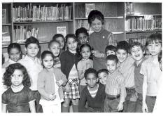 Belpré with children at a library