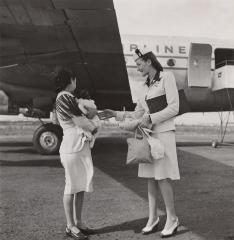 Stewardess greeting a passenger