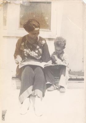 Pura Belpré reading a book to a child