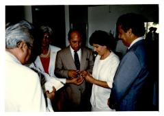 Eddie González and Helen Rodríguez-Trías exchanging wedding rings in ceremony