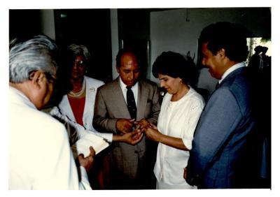 Eddie González and Helen Rodríguez-Trías exchanging wedding rings in ceremony
