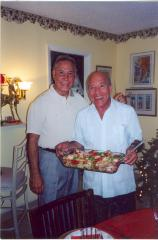 Eddie González (right) presenting a food dish