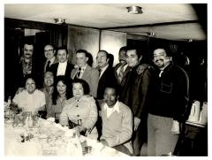Eddie González (second from bottom left) at a gathering for dinner