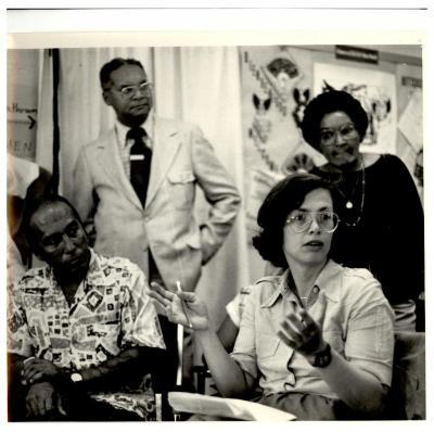 Helen Rodríguez-Trías (sitting at right) in a meeting