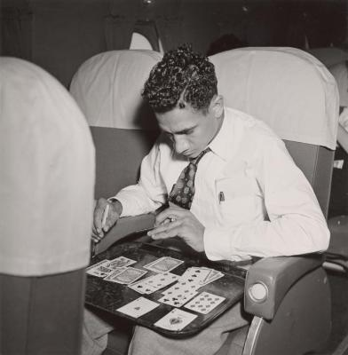 Passenger playing solitaire on a Waterman Airlines flight