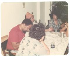 Lillian López, Elba Cabrera, and family at the dinner table